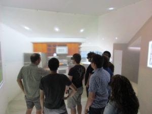 ProCSI 2017 group taking a tour of a lab