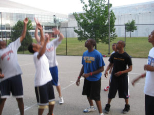 A close-up of a group of ProCSI 2008 members playing basketball