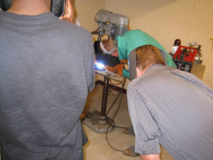 ProCSI 2009 students watch a welder
