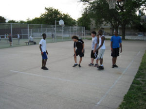 A group of ProCSI 2009 play a game of basketball