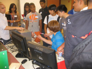 ProCSI 2010 members help in a lab demonstration