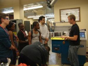 ProCSI 2011 members listen to a lab member