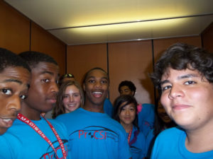 ProCSI 2012 members smile for the camera in an elevator