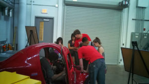 ProCSI 2013 members look at a car in a lab
