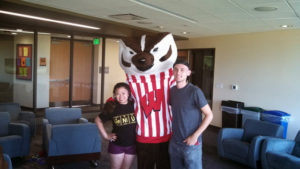 Two ProCSI 2013 members pose with Bucky Badger