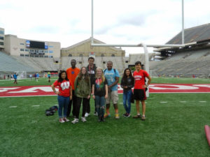 A group of ProCSI 2014 members pose for a picture on the field at Camp Randall