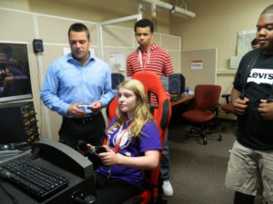 A ProCSI 2014 member tests out a simulator