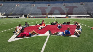 ProCSI 2015 members pose on the W at the center of Camp Randall