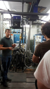 A ProCSI 2015 lab leader gives an explanation of a machine in the lab