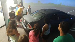 ProCSI 2015 members look at a driving simulator