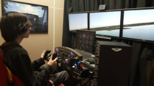 A ProCSI 2015 student focuses while trying a flight simulator