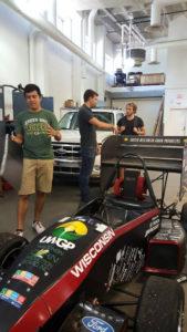 ProCSI 2015 members look at a race car