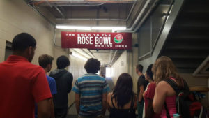 ProCSI 2015 members walk out onto the field at Camp Randall