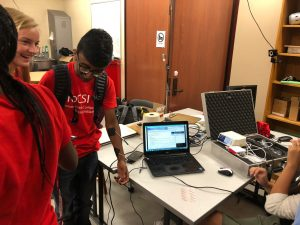 One ProCSI 2018 student volunteers to be hooked up to a machine that stimulates muscles