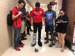 ProCSI 2018 students watch as one tests out a prosthetic leg